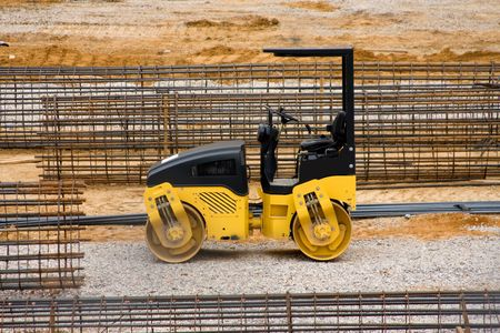 Construction equipment at a work site. Imagens