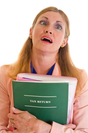 Middle aged woman exhausted after finally completing her taxes for the government. Stock Photo - 3317199