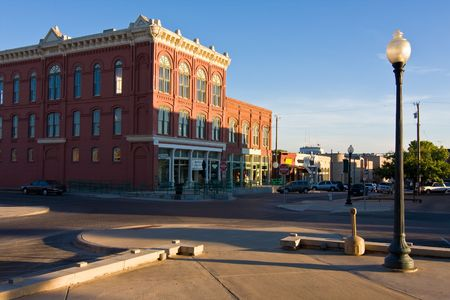 Very quiet day in a typical midwest small town square with a late summer afternoon sun casting long shadows.
