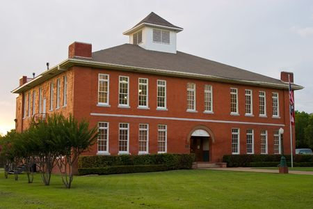 Classic red brick school in typical small town USA location.