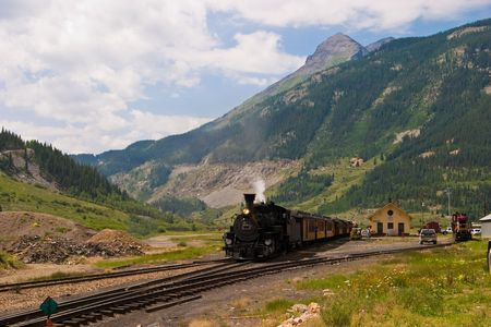 forest railroad: The historic narrow gauge Durango-Silverton steam locomotive approaches Silverton, Colorado. Stock Photo
