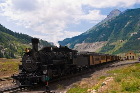 The historic narrow gauge Durango-Silverton steam locomotive approaches Silverton, Colorado. Stock Photo