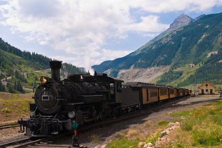 The historic narrow gauge Durango-Silverton steam locomotive approaches Silverton, Colorado. photo