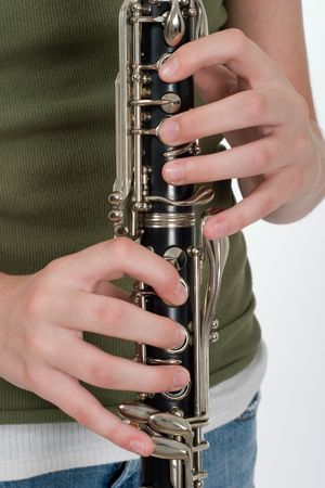 Close-up of a clarinetists hands playing a clarinet. Banco de Imagens