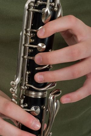 Close-up of a clarinetist's hands playing a clarinet.