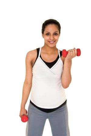 physically: Beautiful young, Hispanic woman in a fitness workout using hand weights to keep herself physically fit during her pregnancy.  Shot on white background.