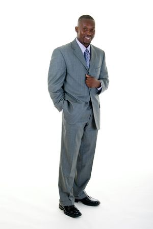 Handsome African American man standing in a gray business suit.