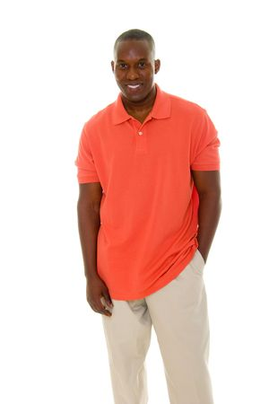 Casual young African American man standing in an orange golf shirt. Stock Photo