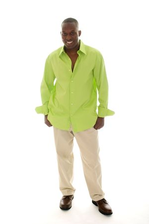 Casual young African American man standing in a bright green shirt.