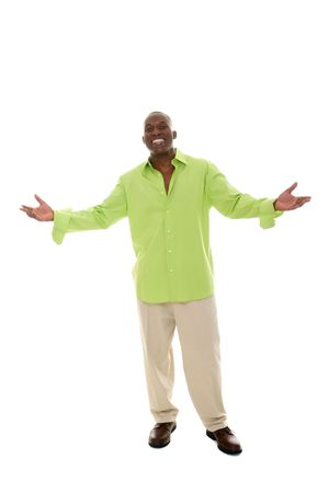 extended: Casual young African American man standing in a bright green shirt with a welcoming hands apart gesture.