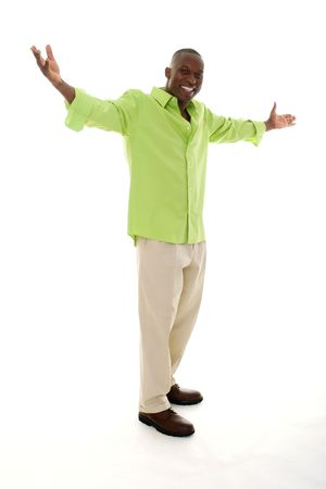 Casual young African American man standing in a bright green shirt with a welcoming hands apart gesture. photo