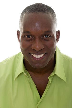 Portrait of a handsome African American man in a bright green shirt and smiling looking directly into the camera. photo