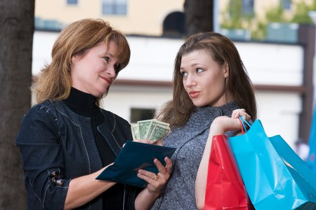 Two women, a Mother and daughter on a shopping trip together in the city. Stock Photo - 4504453
