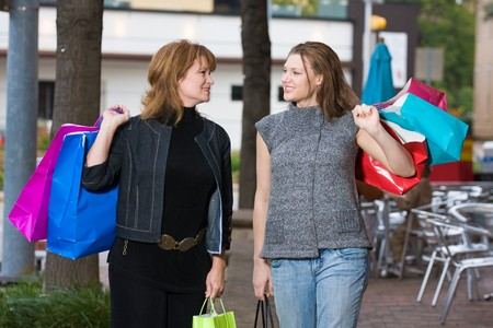 Mother and daughter on a shopping trip together in the city. Stock Photo - 4504463