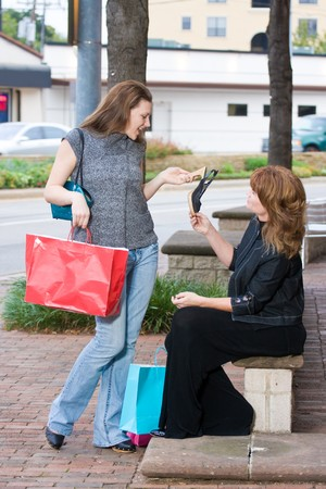 Mother and daughter on a shopping trip together in the city. Stock Photo - 4504462