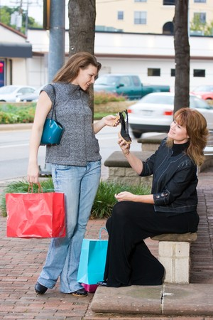 Mother and daughter on a shopping trip together in the city. Stock Photo - 4504465