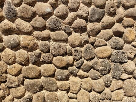 Wall formed with many stones Banco de Imagens