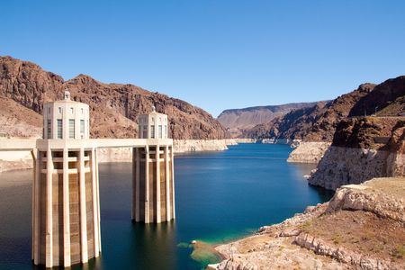 mead: Intake towers, Arizona side of Hoover Dam. View of low water level of Lake Mead Stock Photo