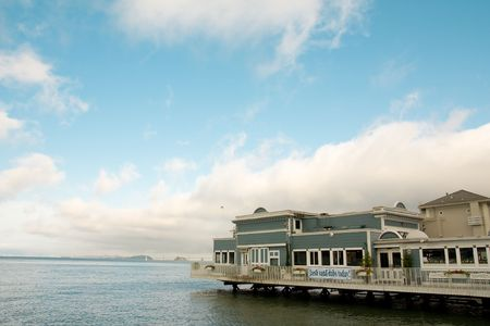 View of waterside building in Sausalito, with view of San Francisco across the bay in the background. Horizontal format. Stock Photo - 4959456