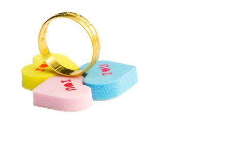 Gold wedding ring with three l love you heart shape Фото со стока