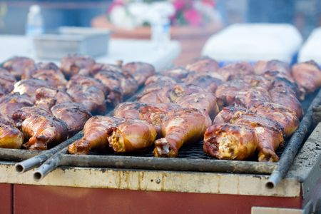 Barbecue smoked turkey drumsticks on the grill