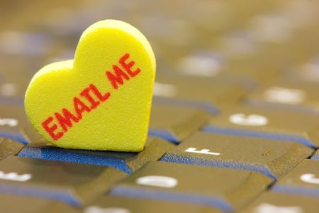 internet love: A heart shape with email me word on a computer keyboard.