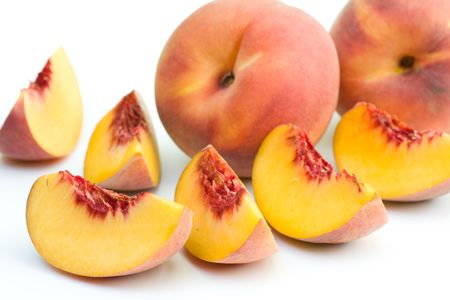 Fresh peaches on white background. Stock Photo