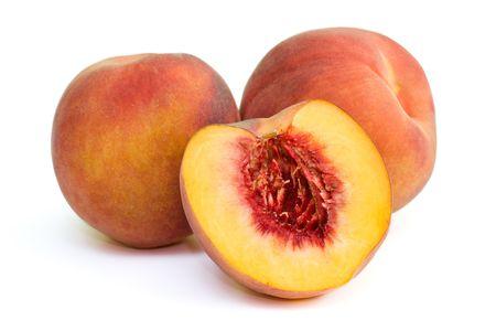 fruitage: Fresh peaches on white background. Stock Photo