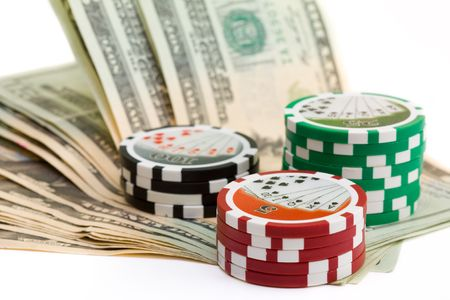 stack of poker chips with cash money on white background
