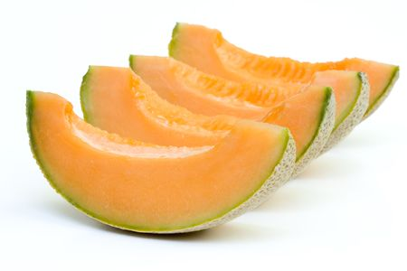 Close up of cantaloupe melon in isolated white background