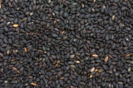 sezam: Nasiona sezamu czarnego w bliska, pchniÄ™cie Zdjęcie Seryjne
