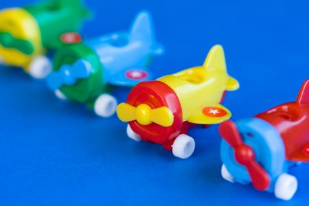 Plastic airplane model toy on blue background Stock Photo