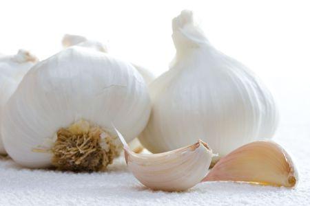 garlics: Close view of garlics on white towel