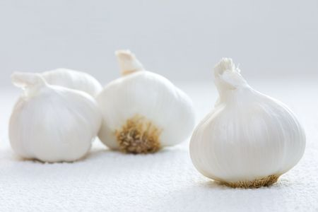 Close view of garlics on white towel photo