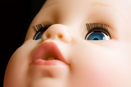 Close up of a doll with the focus on the left eye Stock Photo - 6161596