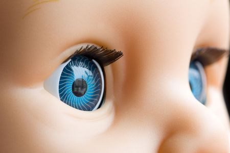 close uo: Close uo of a doll eyes with the focus on the right eye