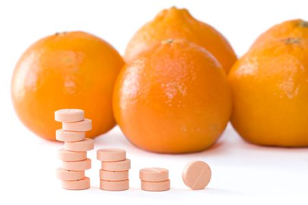 Pills of vitamin C on a background of orange 版權商用圖片