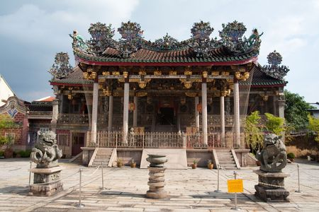 Front view of a beautiful and grand clan temple at Penang with traditional chinese craftsmanship roof photo