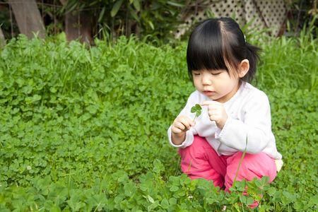 Little Asian child having fun in park Imagens
