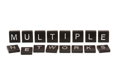 Scrabble tiles spelling out the word, multiple networks photo