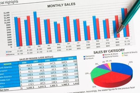 Colorful sales charts and graphs with a pen Imagens
