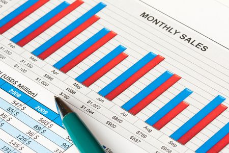 Colorful sales report with a ball pen Stock Photo - 6700185
