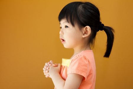 childishness: Portrait of a little Asian baby child girl is praying