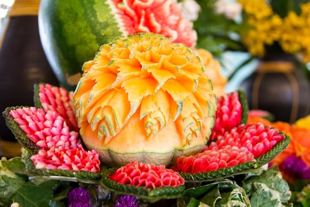 An assortment of fresh carved mix fruits photo