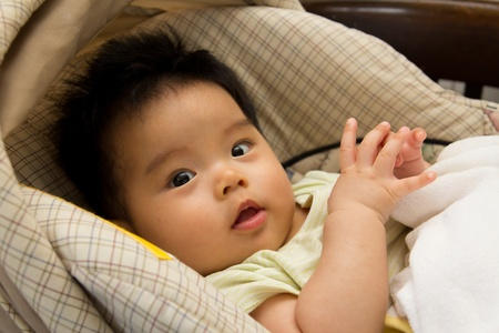 asian baby girl: Asian baby girl in a car seat