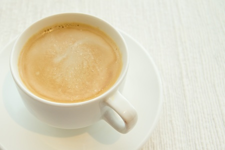 Picture of a cup of coffee on white cloth Stock Photo