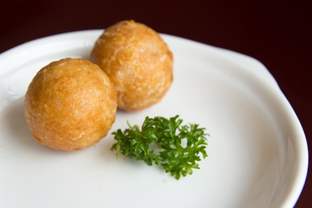 balls deep: Deep fried yam balls served in a white plate Stock Photo