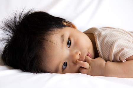 childishness: Portrait of a little Asian baby girl on white background
