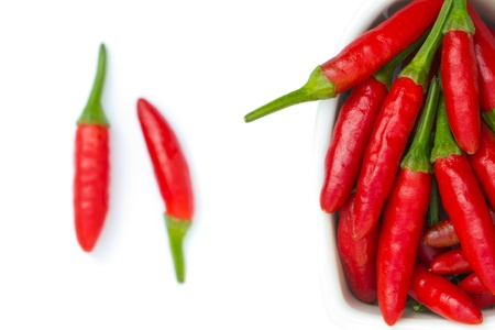 red chilly: Red chilli in a bowl isolated on white background