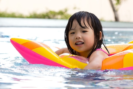 Little girl is having fun in swimming pool Stok Fotoğraf